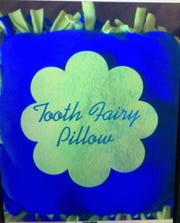 Teela Killam creates tooth fairy pillows and boxes.