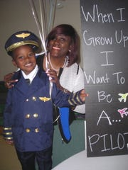 Eli Chapman 4, who wants to be a pilot and fly the president some day, poses with Attorney Jackie Scott at  Eagles' Camp 2019.