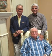Birthday honoree Horace Ladymon (clockwise from seated) with sons-in-law Roger DeKay and Mark Auerbach, who helped give the party.