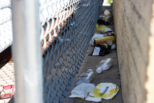 Empty cans, bottles and other trash fills a small ditch in an alleyway off Fairfax Ave. on Thursday, July 11. Residents and business owners say littering, especially that of alcohol containers, has gotten worse.