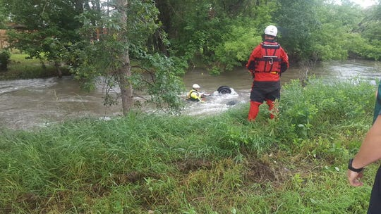 Workers search a submerged, overturned car in Rapid Creek on Sunday, July 14, 2019. Ivan Rice, 23, was found dead inside the car.