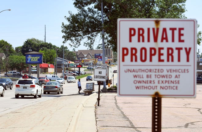 """Businesses near 10th Street and Fairfax Ave post """"private property"""" and """"no loitering"""" signs as seen Monday, July 15, in Sioux Falls. Despite these warnings, greater numbers of transient populations have made the area their home base."""