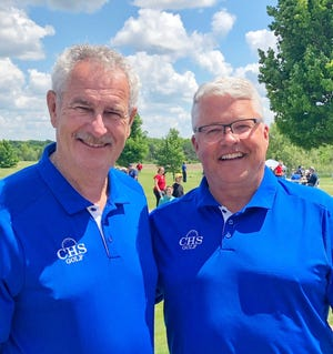 Cathedral High School assistant boys golf coach Jim Schrefels and head coach Pete Loehr.