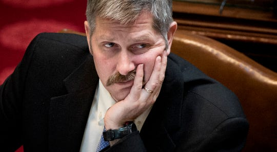 In this March 7, 2013, file photo, Sen. Tony Lourey listens as GOP senators debate the makeup of the board of the health insurance exchange in the bill he sponsored on the Senate floor. Lourey, who became Gov. Tim Walz's Human Services commissioner, has resigned just six months after being appointed.
