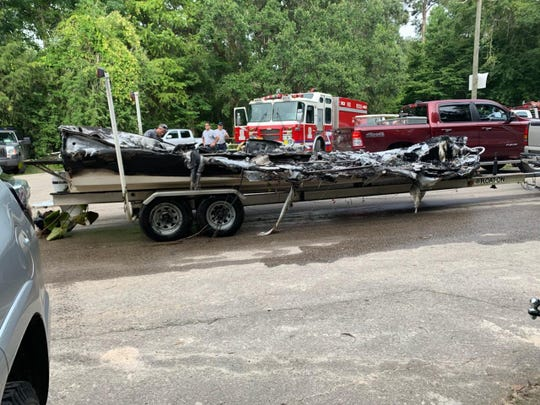 The 24-foot Chaparral boat that caught fire at about 4 p.m. on the weed-filled lake in northern Leon County. The fire left five people swimming for shore.