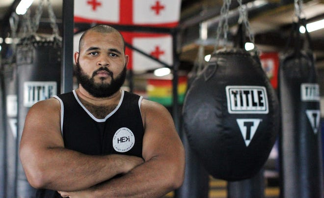 Tallahassee resident MaShawn Knight, a former state champion heavyweight wrestler at Godby High, practices at Train. Fight. Win. in build-up to Knight's first MMA fight at Combat Night at The Moon.