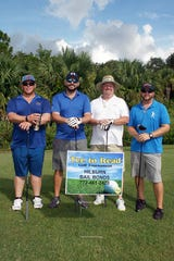 Billy Chapman, left, sponsor Patrick Hilburn, Scott Artman and Kyle Monchester at the Tee to Read Golf Tournament at Gator Trace Golf &Country Club in Fort Pierce.