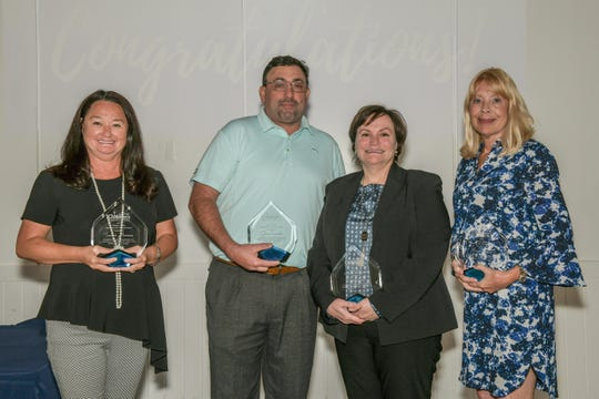 Champion for Children Award winners, from left, Terissa Aronson, Glenn Camelio, Valerie Bell and Karen Bailey.