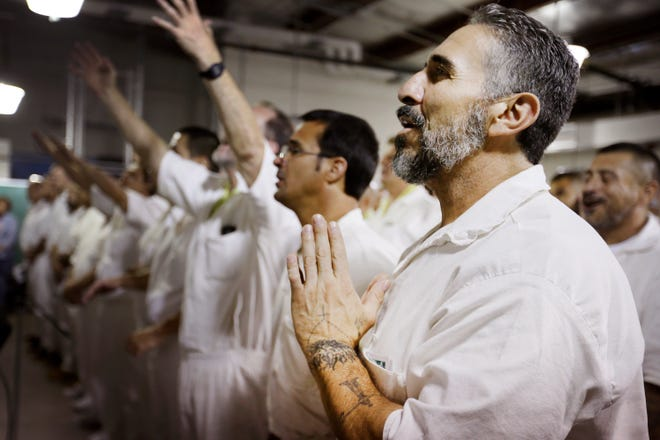 Jesus Gurule prays during the Del Sol Church service at Rogelio Sanchez State Jail Sunday, July 14, in El Paso. Del Sol Church volunteers go to the jail to host a church service for the inmates. Only 85 inmates can attend at a time since the church doesn't have a bigger space to host the services.