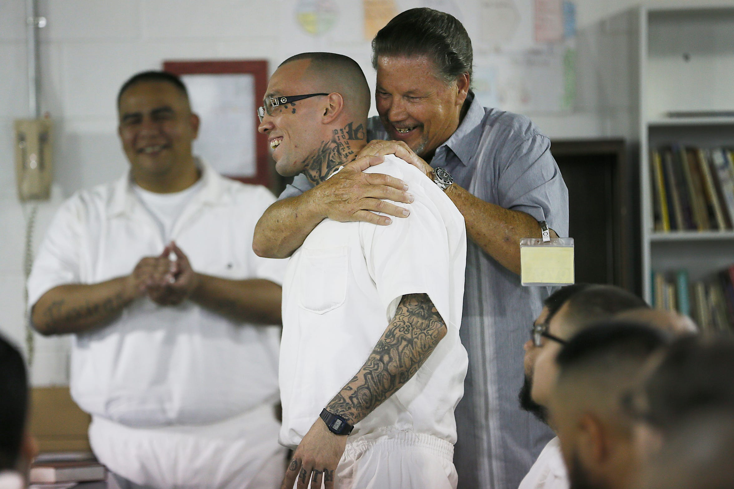 Senior pastor at Rogelio Sanchez State Jail Greg Swann gives David Mackey a hug after his last church service Sunday, July 14, in El Paso.