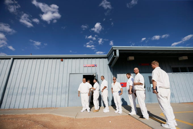 Inmates wait to be patted down by guards so they can attend the last Del Sol Church service of the day at Rogelio Sanchez State Jail Sunday, July 14, in El Paso. Del Sol Church volunteers go to the jail to host a church service for the inmates. Only 85 inmates can attend at a time since the church doesn't have a bigger space to host the services.