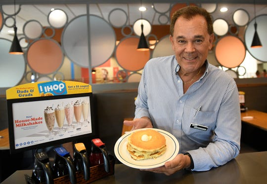 Ken Fitzpatrick, manager at the IHOP in Vineland, holds a plate of pancakes on Monday, July 15, 2019.