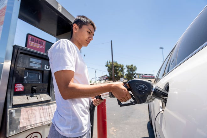 Aliz Alvarez of Visalia pumps fuel at 4 Seasons Handy Market in Visalia on Monday, July 15, 2019.