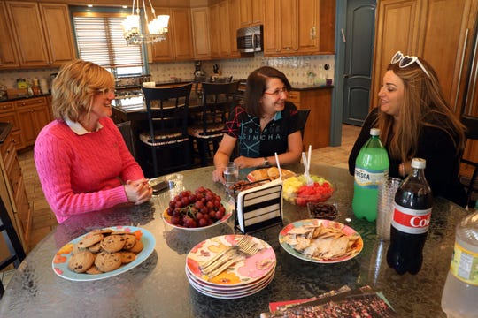 Libby Akerman, left, one of the founders of Tour de Simcha, talks about the bicycle fundraiser with Leah Portnoy Worenklein of White Plains and Perel Lichter of Monsey July 15, 2019 at Akerman's home in Wesley Hills. The 100-mile ride starts in Woodbridge, New Jersey and ends at Sullivan County's Camp Simcha for children with cancer and other chronic illnesses or disabilities.