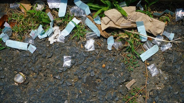 Several empty bags of heroin rest in a parking spot outside a motel room on Rt. 13 in New Castle.