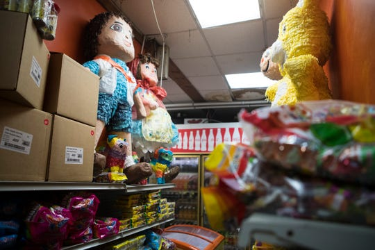 Pi–atas and candy for sale at Joe's Market in Georgetown. The market was started in 1993 by Rodriguez's father Luis Rodriguez.