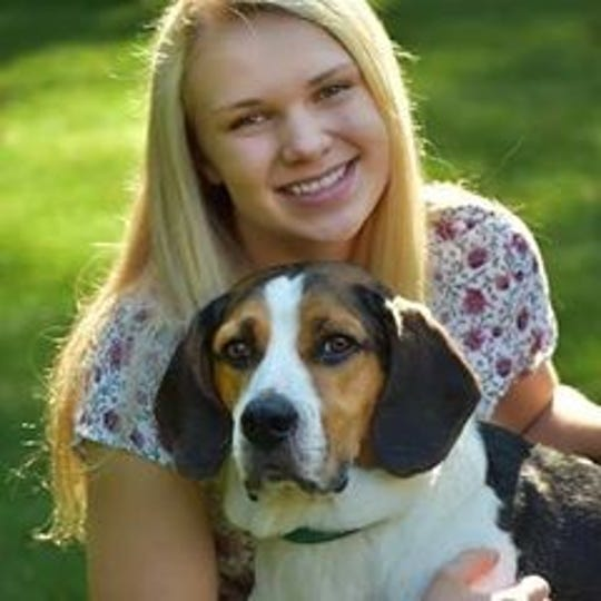 Emily Klopotek with her dog, Max.