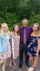 Emily Klopotek with her mom, Chris, her dad, Joe, and her sister, Corinne.