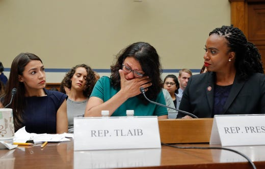 Rashida Tlaib, center, wipes her eyes while testifying before the House Oversight Committee hearing on family separation and detention centers on July 12, 2019 on Capitol Hill in Washington.
