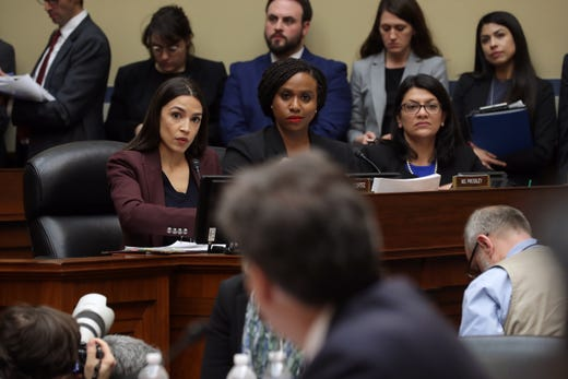 Rep. Alexandria Ocasio-Cortez, Rep. Ayanna Pressley and Rep. Rashida Tlaib listen as Michael Cohen, former attorney and fixer for President Donald Trump, testifies before the House Oversight Committee on Capitol Hill February 27, 2019 in Washington, DC.