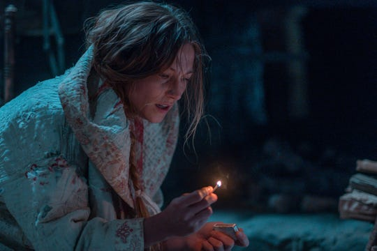 """Lizzy Macklin (Caitlin Gerard) is a frontiersman who feels a sinister force all around her in """"The Wind."""""""