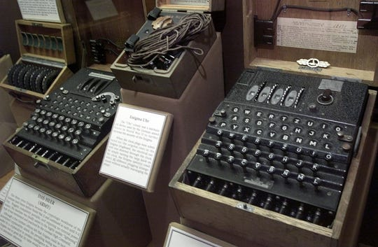 "FILE  --  This is a Tuesday, June 25, 2002 file picture, showing a four-rotor Enigma machine, right, once used by the crews of German U-boats in World War II to send coded messages, which British World War II code-breaker mathematician Alan Turing, was instrumental in breaking, and which is widely thought to have been a turning point in the war. Homosexuality was illegal in Britain at that time and Alan Turing received medical treatment following his conviction for what was considered indecency, however British Prime Minister Gordon Brown has apologized for the ""inhumane"" treatment  which was metred out to Turing, in a published apology Friday Sept. 11, 2009. (AP Photo/Alex Dorgan Ross) ORG XMIT: LON101"