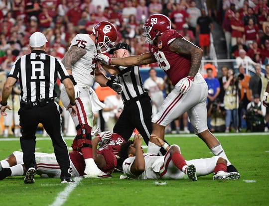 Oklahoma offensive lineman Dru Samia (75) react after quarterback Kyler Murray is hit against Alabama in the 2018 Orange Bowl.