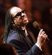 Stevie Wonder sings during the Presidential Inauguration Gala Sunday, Jan. 19, 1997 at the USAir Arena in Landover, Md. The inaugural show is a star-studded soiree featuring many entertainers who have never performed together. (AP Photo/ ORG XMIT: XLDV112