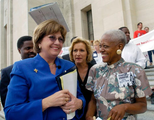Then-Gov. Kathleen Blanco, left, talks with Sadie Roberts-Joseph, right, before the start of the Stand Up for Children 2004 Rally for Children on the steps of the state Capitol in Baton Rouge, La.
