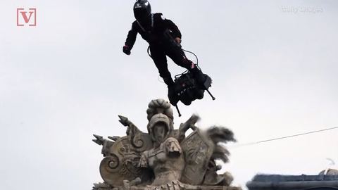 French inventor flies hoverboard over crowd at Bastille Day celebration.