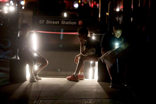 Tourists from Italy try to find a way back to their hotel in Brooklyn after the subways shut down.