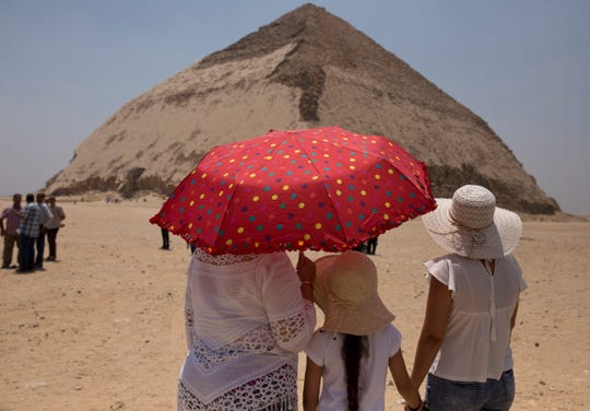 People visit the Bent Pyramid during an during an event opening the pyramid and its satellites for visitors in Dashur, Egypt, Saturday, July 13, 2019.