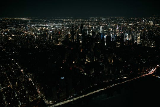 Seen from the air, a large section of Manhattan's Upper West Side and Midtown neighborhoods sit coated in darkness during the partial blackout.