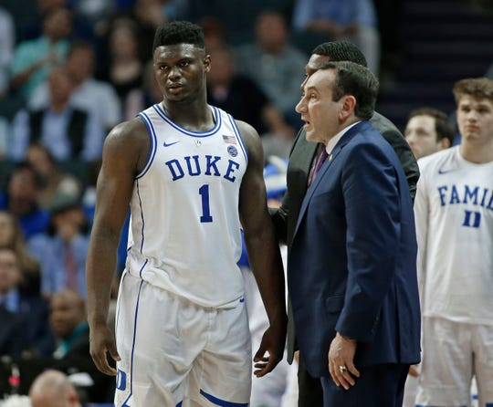 Duke's Zion Williamson (1) talks with head coach Mike Krzyzewski, right, during the second half of an NCAA college basketball game against Syracuse in the Atlantic Coast Conference tournament in Charlotte, N.C., Thursday, March 14, 2019.