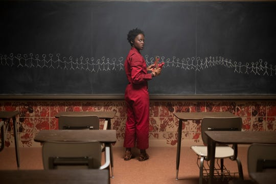 "Red (Lupita Nyong'o) brings about a doppelganger revolt inspired by Hands Across America in ""Us."""