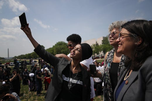 Ilhan Omar takes a selfie with Rashida Tlaib and political activist Angela Davis at an event outside the U.S. Capitol on April 30, 2019 in Washington, DC.