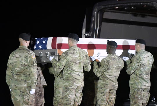 An Army carry team moves a transfer case containing the remains of Sgt. Maj. James G. Sartor at Dover Air Force Base, Delaware, on July 15, 2018. According to the Department of Defense, Sartor, 40, of Teague, Texas, died July 13, 2019, in Faryab province, Afghanistan, of injuries sustained from enemy small arms fire.