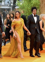 """Beyonce Knowles-Carter and Jay-Z attend the European Premiere of Disney's """"The Lion King"""" on July 14, 2019 in London."""