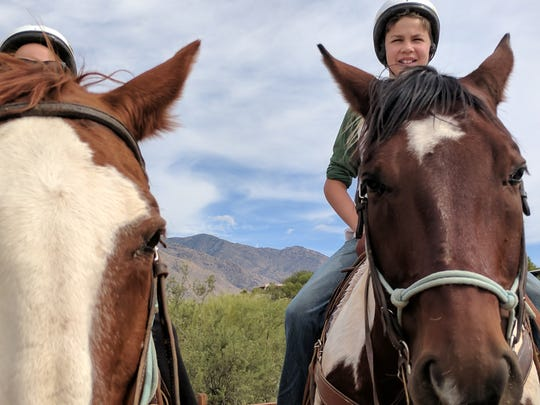Erysse and Iden on a horseback ride in Tucson in October 2018. I got close to the horses with my Pixel 2, but they also tried to eat my phone.