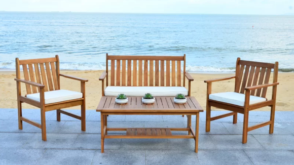 The Lark Manor Joliet 4-Piece patio set features a loveseat, two chairs, and a coffee table.
