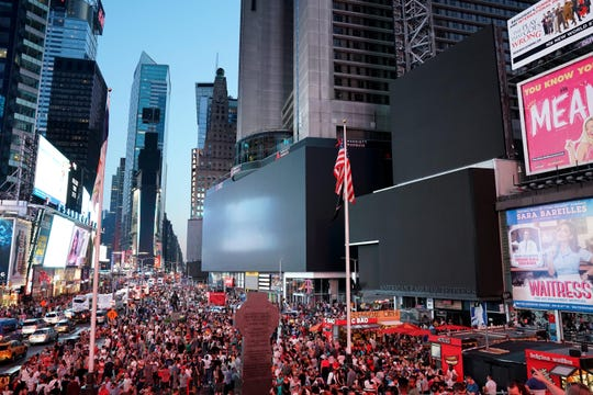Video screens in Times Square go out.