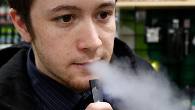 Nick Gregory, 26, vapes on a Juul in Lexington, Kentucky.