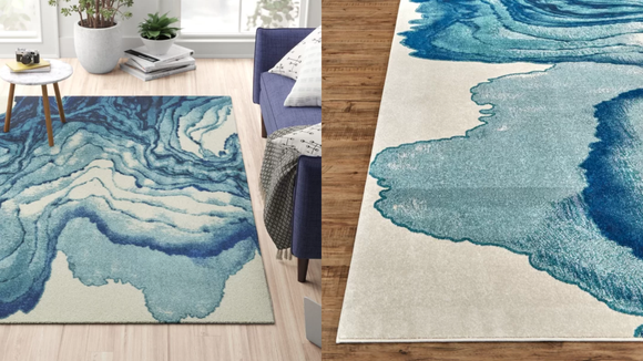 This Zipcode Design Stuart Blue/Beige Area Rug can tie together any room.