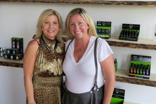 CBD For Life owner Beth Stavola (left) is shown with her sister and co-founder Julie Winter during an interview in their office at the the Galleria in Red Bank Monday, July 15, 2019.  The company was recently acquired by a New York City cannabis company for $10.4 million.