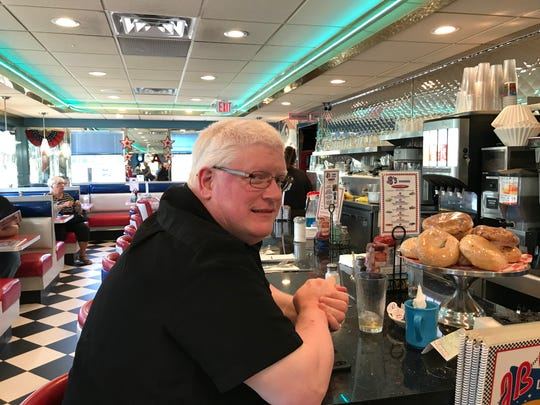 Farmingdale resident Matt Hughes discusses President Trump's latest tweets at JB's Diner on 33