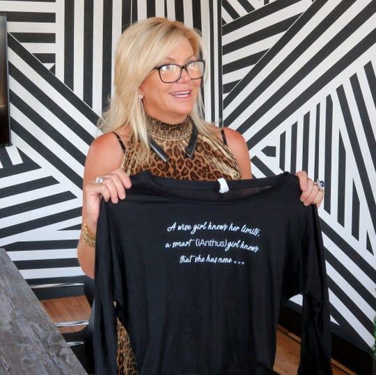 CBD For Life owner Beth Stavola holds a shirt given to her employees during an interview in her office at the the Galleria in Red Bank Monday, July 15, 2019.  The company was recently acquired by a New York City cannabis company for $10.4 million.