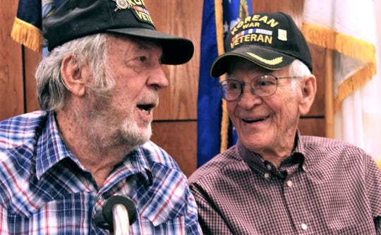 Clifford Archa, left, talks with fellow Korean War veteran Johnny Greenfield after a group photo was taken Thursday at a dinner at the West Texas Rehabilitation Center. July 11, 2019
