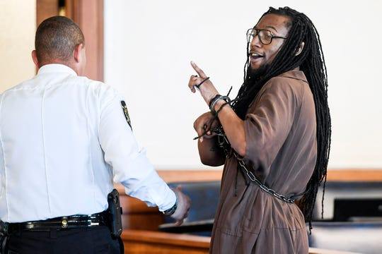 "Nathaniel Dixon says ""love y'all,"" to people in the courtroom after being sentenced to life in prison July 16, 2019 in Asheville."