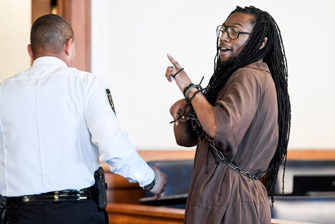 """Nathaniel Dixon says """"love y'all,"""" to people in the courtroom after being sentenced to life in prison July 16, 2019 in Asheville."""