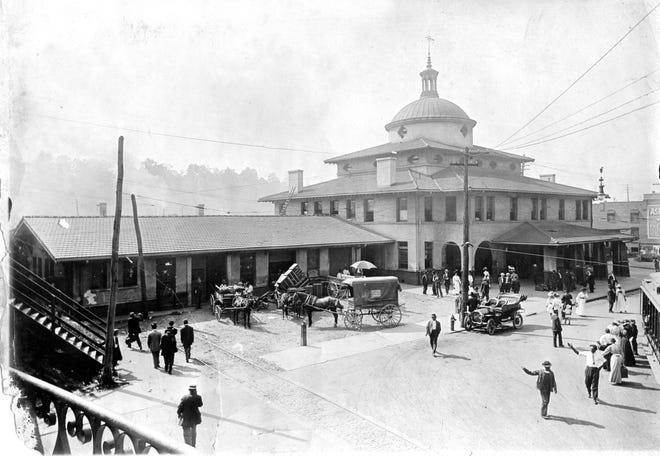 """The main train station in Asheville, built circa 1905, was this white stucco palace on Depot Street across from the Glen Rock Hotel. It survived the Flood of 1916; and was razed after the final run of the Greensboro-to-Asheville """"Carolina Special"""" on Dec. 5, 1968."""